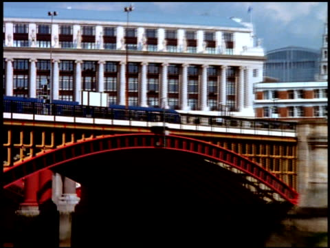 zoom out as train passes along blackfriars railway bridge over river thames, london - railway bridge stock videos & royalty-free footage
