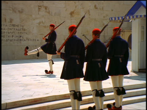 zoom out pan changing of the guard (evzones) at tomb of the unknown soldier at parliament / athens, greece - military parade stock videos and b-roll footage