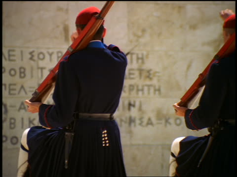 rear view zoom out changing of the guard at tomb of the unknown soldier / parliament, athens - greece stock videos & royalty-free footage
