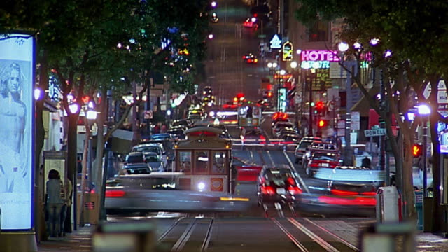 zoom out city street / time lapse traffic and trolleys / san francisco - san francisco california stock videos and b-roll footage