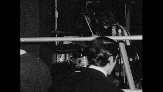 zoom out drummer at night club, london; 1967 - pop music stock videos & royalty-free footage