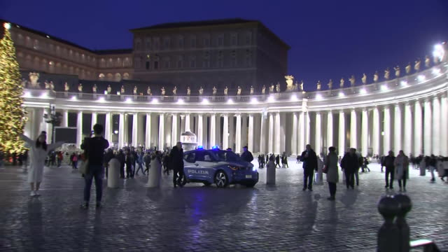 zoom out establishing shot of police car in st peter's square - crime or recreational drug or prison or legal trial video stock e b–roll