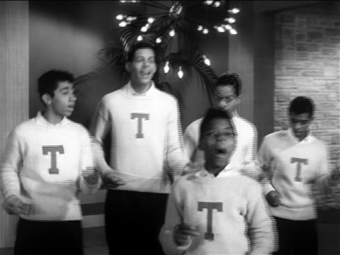 b/w 1956 zoom out frankie lymon teenagers performing i'm not a juvenile delinquient on stage / feature - early rock & roll stock videos & royalty-free footage