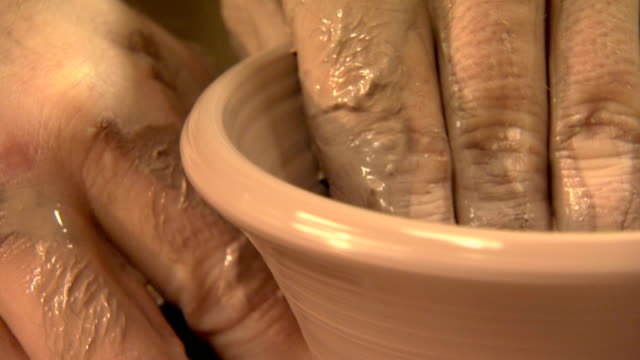 zoom out from, a close up on clay being formed into a cup, to the artist  - potter stock videos & royalty-free footage