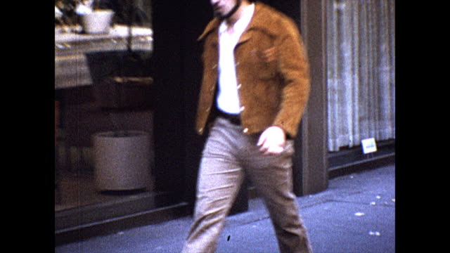 zoom out from a man's crotch to him walking down the street in new york city - pelvi video stock e b–roll