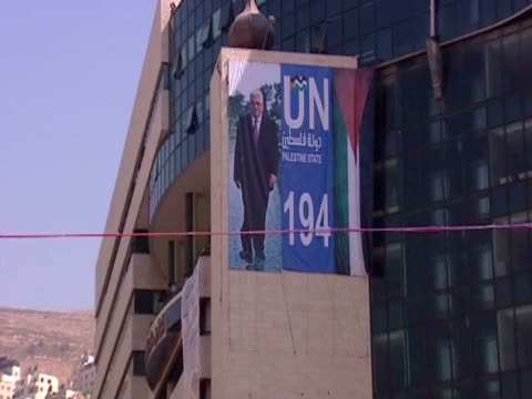 zoom out from a poster of palestinian leader mahmoud abbas to a rally organised in nablus to support his request to the united nations to admit... - poster stock videos & royalty-free footage