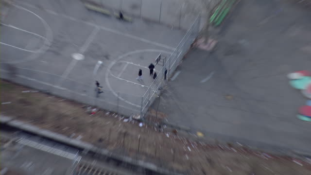 bronx, new york - march 8, 2011: zoom out from an urban basketball court to an aerial view of the claremont village housing projects in the bronx, new york city. - building storey stock videos and b-roll footage