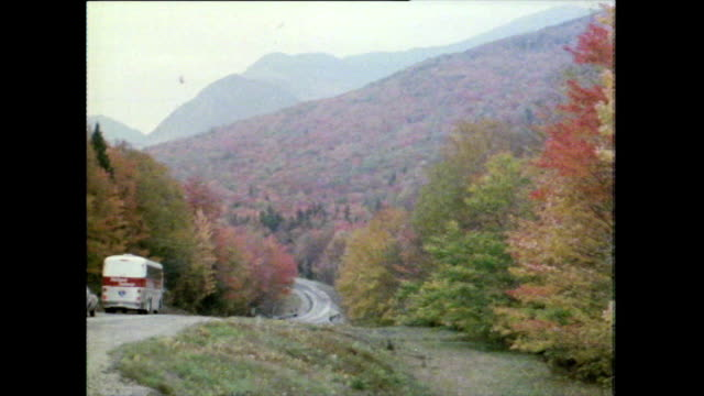 zoom out from autumn trees and winding road; 1981 - appalachia stock videos & royalty-free footage