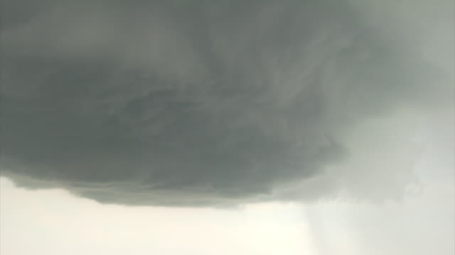 Zoom out from base of Supercell thunderstorm to reveal updraft and vault region.