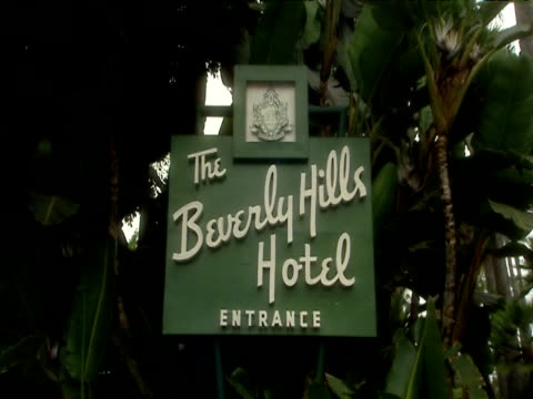 zoom out from beverly hills hotel sign hotel in background hollywood - beverly hills hotel stock videos and b-roll footage