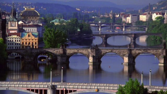 zoom out from bridges to wide shot vltava river and prague / czech republic - vltava river stock videos & royalty-free footage