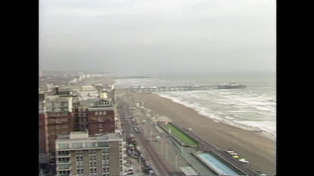zoom out from brighton pier to wide shot general view of brighton seafront on an overcast day; 1986. - overcast stock videos & royalty-free footage