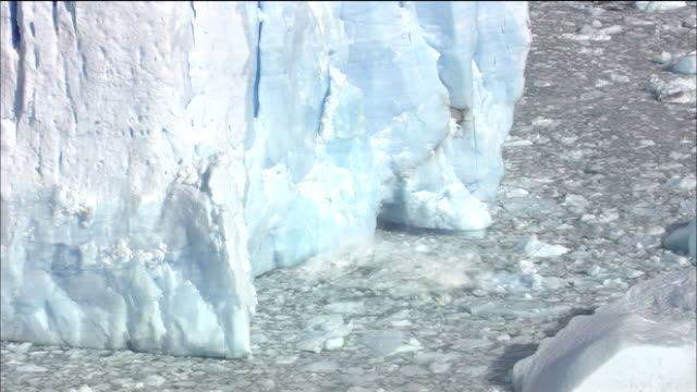zoom out from calving moreno glacier, lago argentino, patagonia - patagonia chile stock videos and b-roll footage