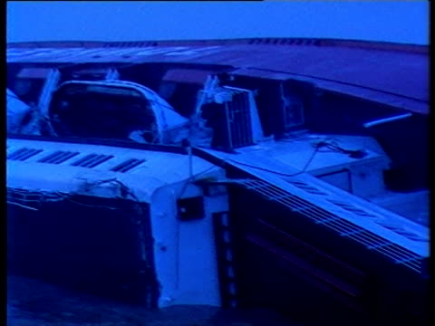 stockvideo's en b-roll-footage met zoom out from capsized ferry at dawn - zeebrugge