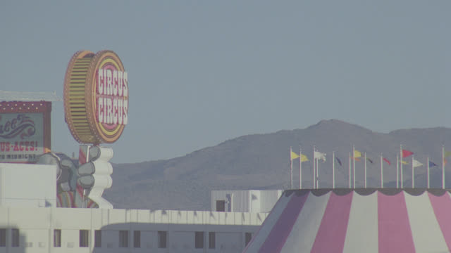 zoom out from circus circus sign to reveal reno skyline - casino sign stock videos & royalty-free footage