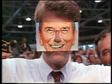 1984 zoom out from close up man wearing ronald reagan mask at republican national convention / dallas - 1984 stock videos & royalty-free footage