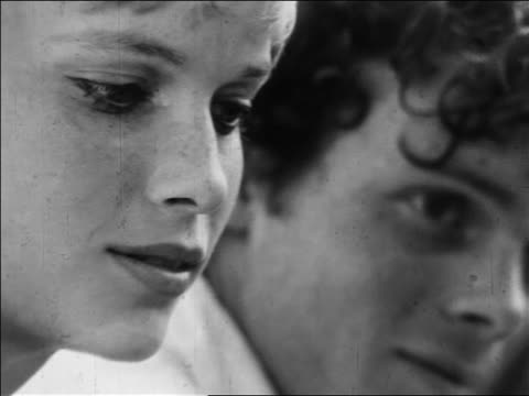 b/w 1968 zoom out from close up mia farrow looking down outdoors / newsreel - mia farrow stock videos & royalty-free footage