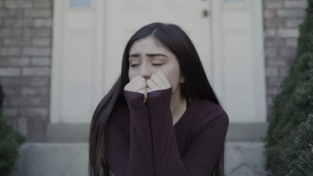 vidéos et rushes de zoom out from close up of crying girl listening to abuse / springville, utah, united states - crier