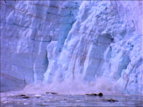 zoom out from close up of ice falling into water from Sawyer Glacier / Alaska