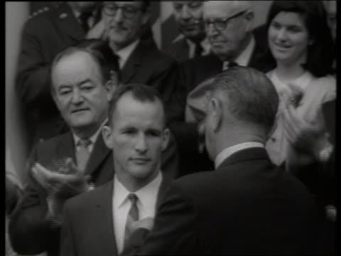 b/w zoom out from close up president johnson awarding gemini astronaut / ed white 1960's / sound - ed white astronaut bildbanksvideor och videomaterial från bakom kulisserna