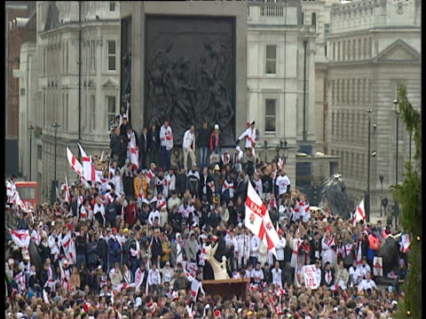 zoom out from crowd at bottom of nelson's column to entire trafalgar square england rugby union world cup victory parade; 08 dec 03 - nelson's column stock videos and b-roll footage