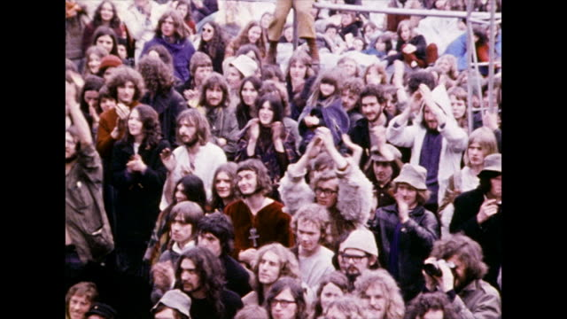 zoom out from crowd of fans clapping and cheering; 1972 - candid stock videos & royalty-free footage