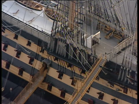 zoom out from deck and rigging of hms victory at naval docks portsmouth - sailing ship stock videos & royalty-free footage