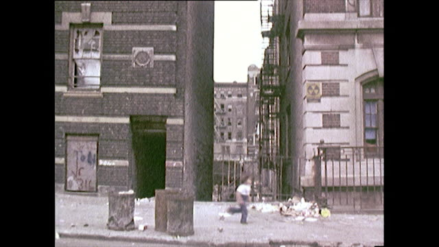 zoom out from derelict apartment building; new york, 1972. - general view stock videos & royalty-free footage