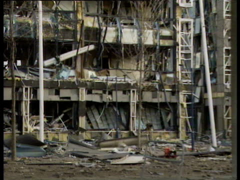 Zoom out from Docklands Light Railway and buildings damaged in IRA Docklands Bombing 10 Feb 96