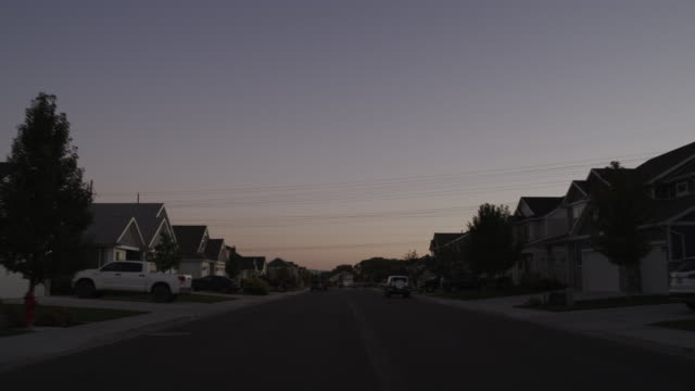 zoom out from empty neighborhood street / lehi, utah, united states - lehi stock videos & royalty-free footage
