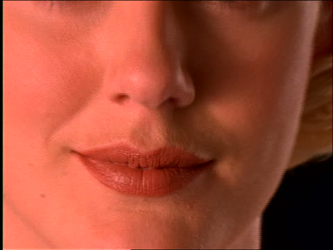 zoom out from extreme close up of lips to woman's face - zoom out stock videos & royalty-free footage