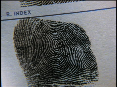 zoom out from extreme close up sheet of fingerprints - 犯罪点の映像素材/bロール