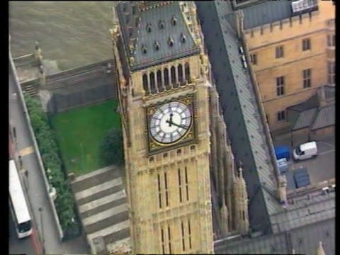 Zoom out from face of Big Ben over Houses of Parliament London; 02 Jun 03