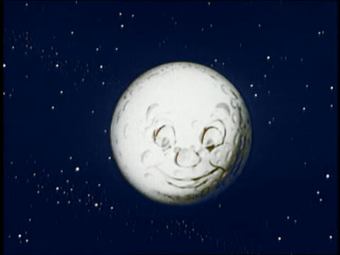 1954 animation zoom out from face of moon / moon winks and fades out / audio - moon stock videos & royalty-free footage
