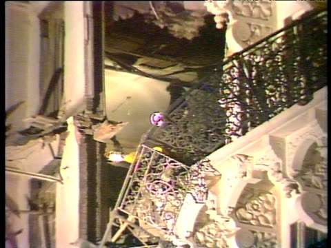 zoom out from firemen with torches to wreckage of hotel ira bombing of grand hotel brighton 12 oct 84 - bombing stock videos & royalty-free footage