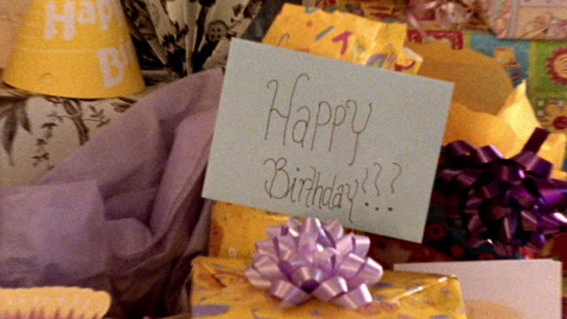 """zoom out from """"happy birthday"""" written on card to table full of birthday gifts - war in afghanistan: 2001 present stock-videos und b-roll-filmmaterial"""