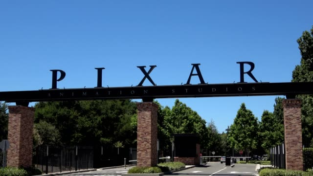 zoom out from logo on entrance gates at headquarters of animation company pixar in downtown emeryville, california, june 12, 2018. - emeryville stock videos & royalty-free footage
