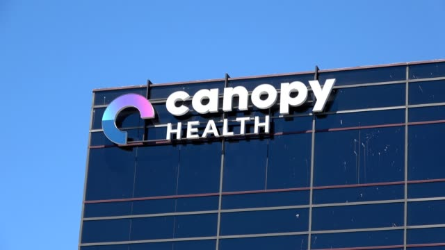 zoom out from logo on facade at canopy health, a healthcare company in emeryville, california, 2018. - emeryville stock videos & royalty-free footage
