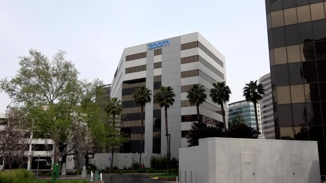 stockvideo's en b-roll-footage met zoom out from logo on facade at headquarters of zoom video communications in the silicon valley, san jose, california, march 28, 2020. - zoom out