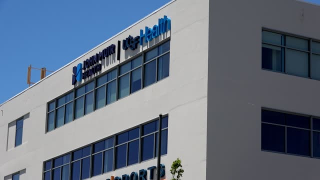zoom out from logo on facade of berkeley outpatient medical center for john muir health and university of california san francisco in berkeley... - outpatient care stock videos & royalty-free footage
