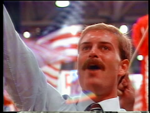 1984 zoom out from man holding arm up cheering at republican national convention / dallas - partito repubblicano degli usa video stock e b–roll