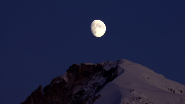 zoom out from moon to reveal mountain in foreground - portland oregon snow stock videos & royalty-free footage