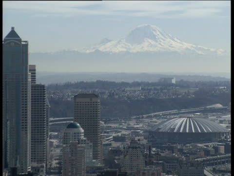 Zoom out from Mount Rainier to downtown high rise buildings