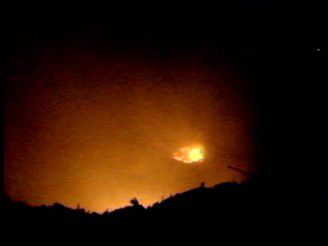 zoom out from orange glow of flame to silhouette of policeman lockerbie air disaster 21 dec 88 - lockerbie stock videos & royalty-free footage