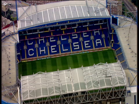 zoom out from painted chelsea seats in stamford bridge football stadium chelsea - スタンフォードブリッジ点の映像素材/bロール