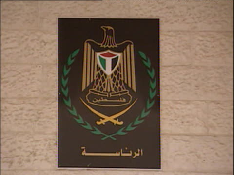 zoom out from palestinian emblem on entrance of yasser arafat's head quarters ramallah; 2001 - ramallah stock videos and b-roll footage