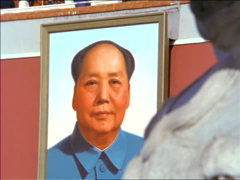 zoom out from portrait of mao zedong to stone lion in front on beijing palace / tiananmen square / 1994 or 1995 - 1994 stock videos and b-roll footage