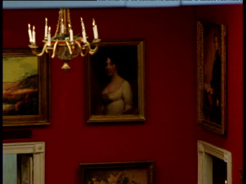 Zoom out from portrait of woman in dolls' house version of White House Red Room