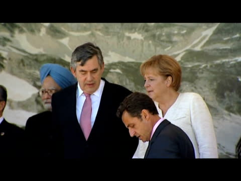 zoom out from prime minister manmohan singh prime minister gordon brown chancellor angela merkel and president nicolas sarkozy as they pose for press... - g8 summit stock videos & royalty-free footage