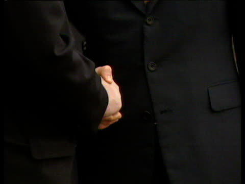 zoom out from prime minister tony blair and taoiseach bertie ahern posed handshake for press at stormont good friday peace accord; 10 apr 98 - 1998 stock-videos und b-roll-filmmaterial